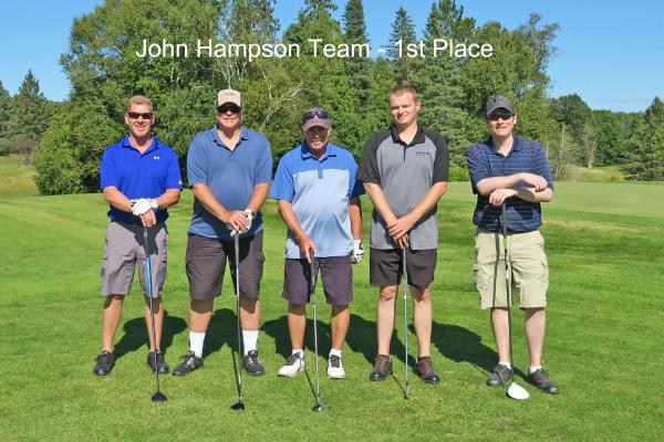 1st place team, John Hampson Team on golf course